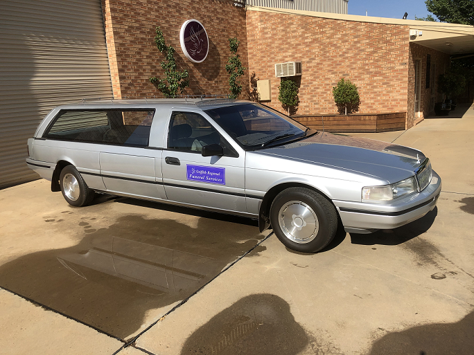 1991 SILVER FORD HEARSE